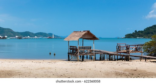 Old wooden jetty on tropical beach island, Thailand