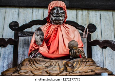 The old wooden Jizo statue in front of the main hall at Todai-ji temple at Nara, Japan. Binzurusonja statue at the outer walls of the Daibutsuden hall at the Todaiji temple.