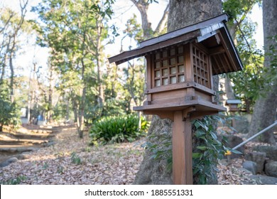 An old wooden lantern in the shrine, Yoyogi Hachiman shrine, Japan