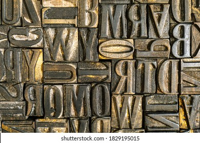 Old wooden letterpress used in a printing press to create reliefs by impressing them against sheets of paper after covering them with ink. Jumbled anique letters. Alphabet background.