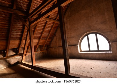 Old wooden loft with window and roof.
