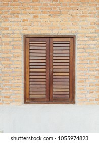 Old Wooden Louver Window on Brick Wall. Vertical Style.