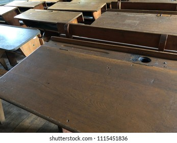 Old wooden made forms in a School room