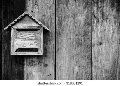 Old wooden mailbox with old vintage wooden background, Monochrome