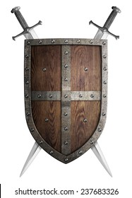 old wooden medieval crusader shield and two crossed swords isolated