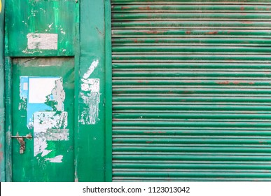 Old wooden and metal entrance door closed with metal key lock texture background