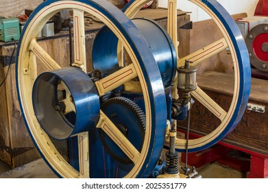 Old wooden and metal spoke wheels of a vintage steam driven tractor.