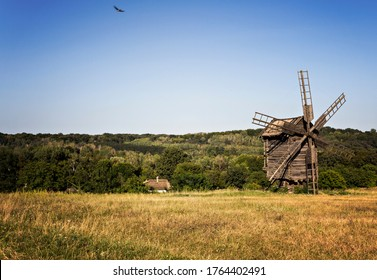 old wooden mill among the field
