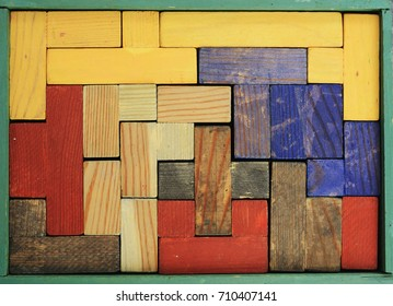 old wooden multicolored puzzle in rectangular box