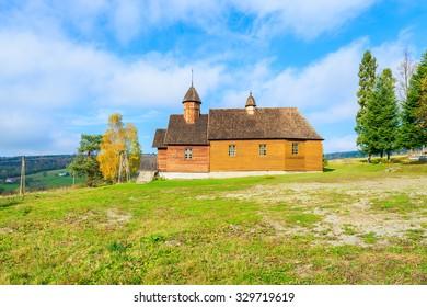 Old wooden orthodox catholic church in Oderne village on sunny autumn day, Beskid Niski Mountains, Poland