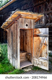 old wooden outhouse at a farm