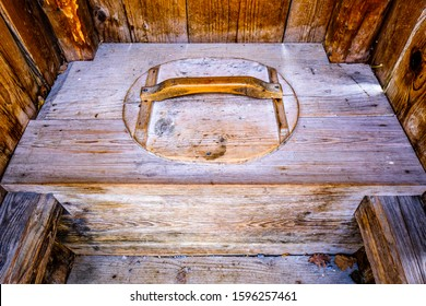 old wooden outhouse at a forest