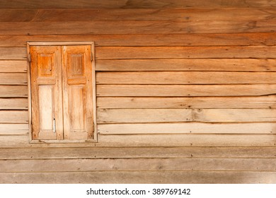 Old wooden panel and window.