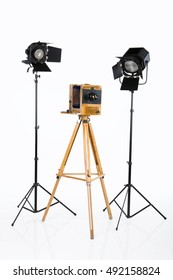Old wooden photographic camera and lighting