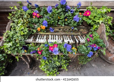 Old wooden piano decorated with flowers