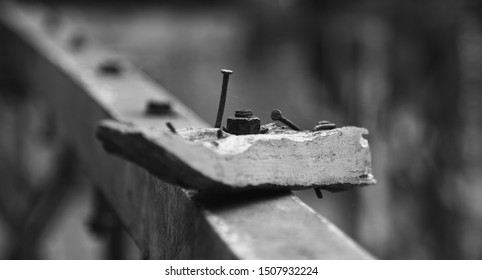 An old wooden pieces isolated black and white photo