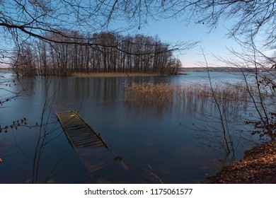 An old wooden pier in the lake at bright night