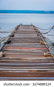 Old wooden pier in the marina of Crikvenica. Photography taken on an early morning. Crikvenica is a popular holiday resort in Kvarner riviera in Croatia