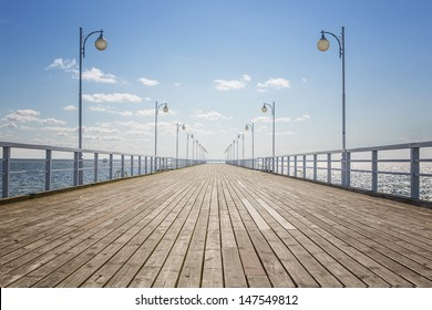Old wooden pier over the sea shore with copy space