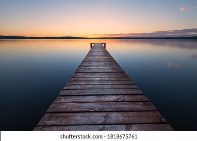Old wooden pier at sunset. Long exposure, linear perspective - Shutterstock ID 1818675761