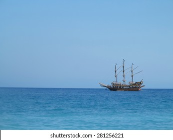 Old wooden pirate old ship in blue sea