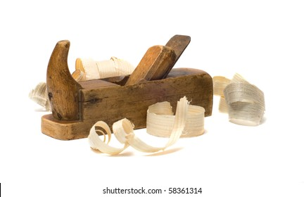 Old wooden plane and chips on a white background.