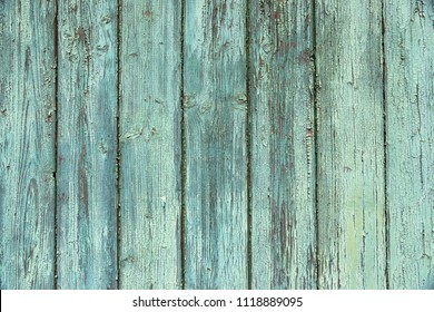 old wooden plank with cracked paint