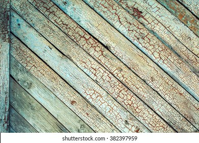Old wooden planks with cracked blue color paint background