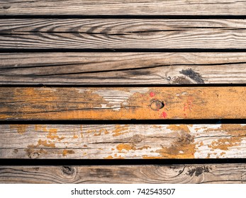 Old wooden planks gritty wood texture  autumn fall rustic background orange and red paint splatters flecks with copy space series