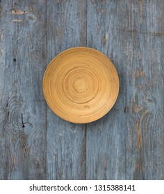 old wooden plate on blue rustic wooden background