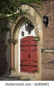 An old wooden red a white church door