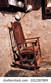 old wooden rocking chair, old crafts chair from Galicia, Galician ethnographic museum, Galician rural furniture,