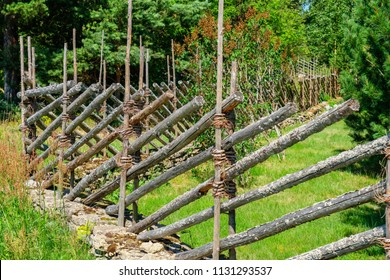 Old wooden roundpole fence in Estonia. Europe