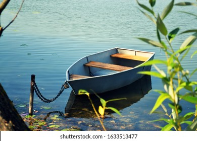 Old wooden row boat on the water