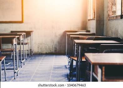 old wooden row lecture chairs in classroom in poor rural school concept for education