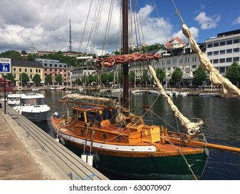 Old wooden sail boat in harbor at Arendal Norway