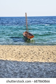 Old wooden sailing boat on the sea shore