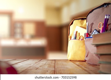 old wooden school table and school supplies on September day