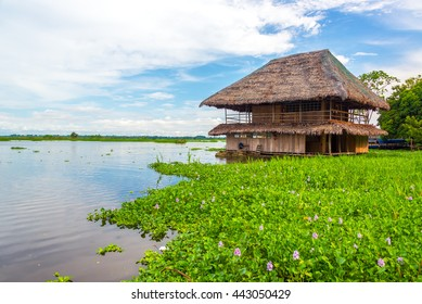 Old wooden shack floating on the Amazon River in Iquitos, Peru
