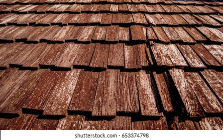 Old wooden shake roof. Background and texture.