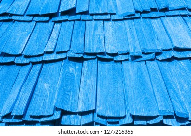 Old wooden shingle roof in blue color