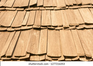 Old wooden shingle roof in brown color