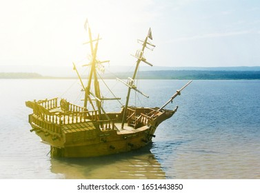 old wooden ship with a mast anchored in the sun
