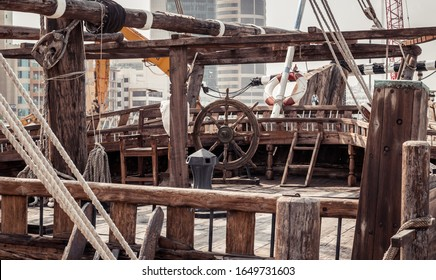 Old wooden ship wheel is the main subject kept in ship graveyard for years as history of ancient times.