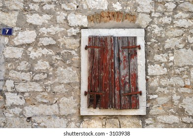 old wooden shutters, house number seven