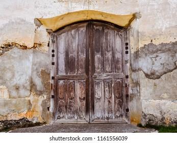 Old wooden side door of old San Isidro Labrador Parish Church (Lazi Church) - Lazi, Siquijor, Philippines