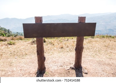 Old wooden sign is located in beautiful nature,with place for text.
