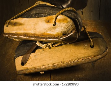 Old wooden skates 1938-1940 years on a wooden background in retro style