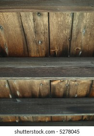 An old wooden slat ceiling with exposed beams