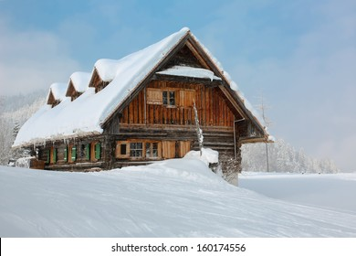 old, wooden, snowy ski lodge in the Alps